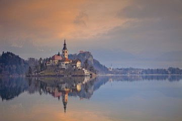 Lake Bled with St. Marys Church of the Assumption on the small island. Bled, Slovenia, Europe.