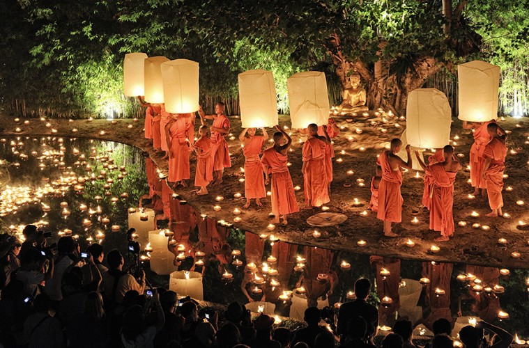 Chiang Mai, Thailand - November 28, 2012: Traditional monk lights floating balloon made of paper annually at Wat Phan Tao temple during the Loi Krathong Festival.